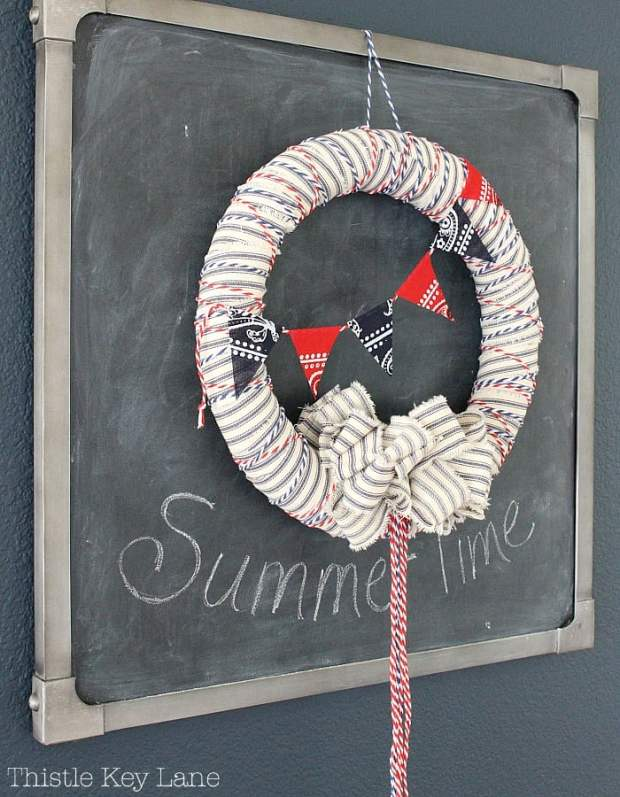 Decorate a chalkboard with a summer wreath.