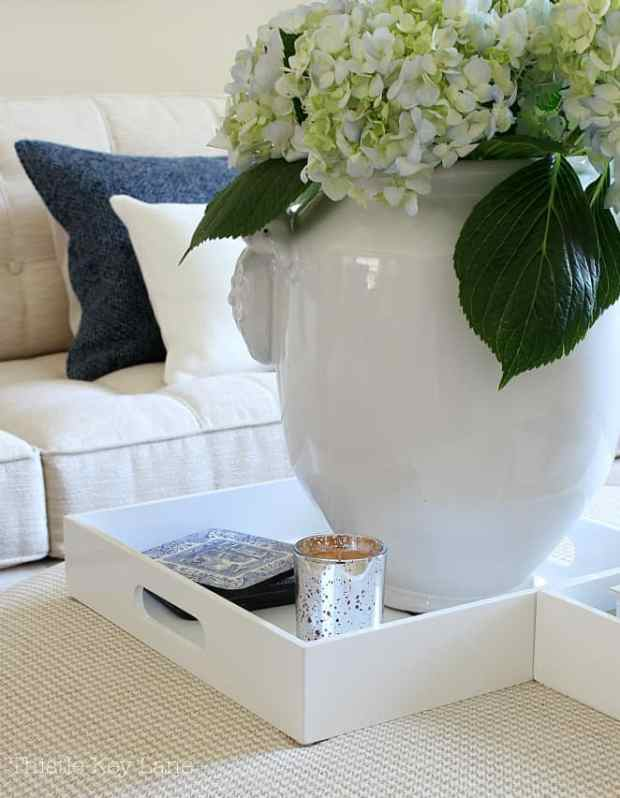 Summer home tour with blue and white accents on trays.