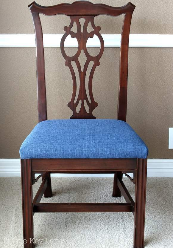 Dining room chair with finished seat cushion.