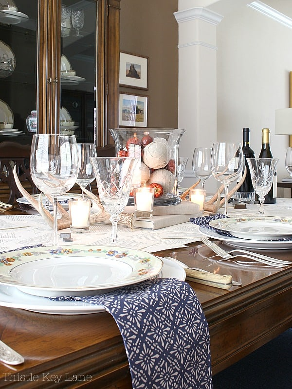Tablescape using a book page table runner mixing old and new.