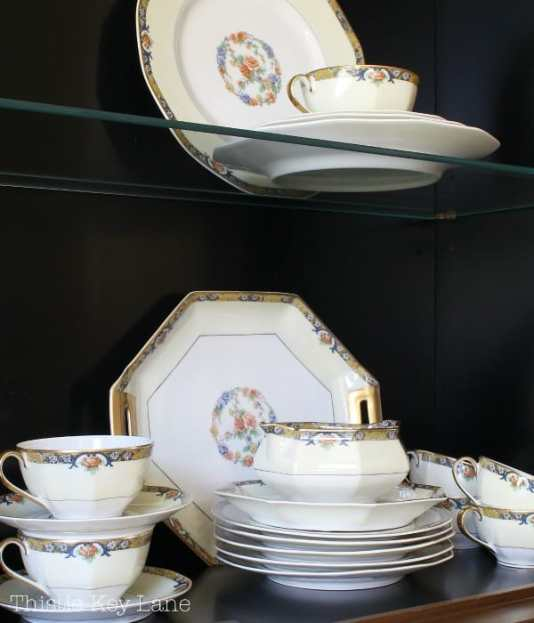 Group odd shaped china pieces together. #chinacabinet #chinacabinetstyle #frenchcountrychinacabinet
