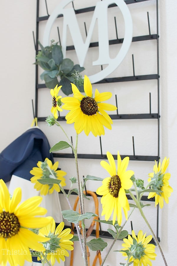 Sunflowers accent the new initial eucalyptus wreath