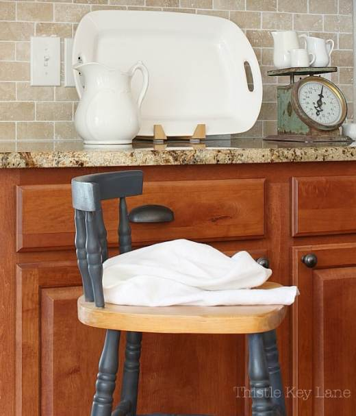 Fall kitchen with an old chair and white accents. So easy to copy.