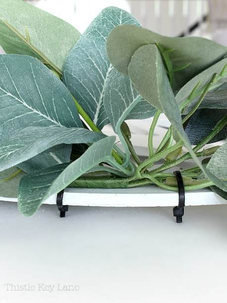 Eucalyptus attached to wreath with zip ties.