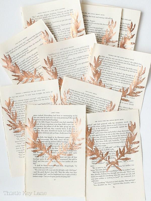 Copper leaf laurel on book pages.