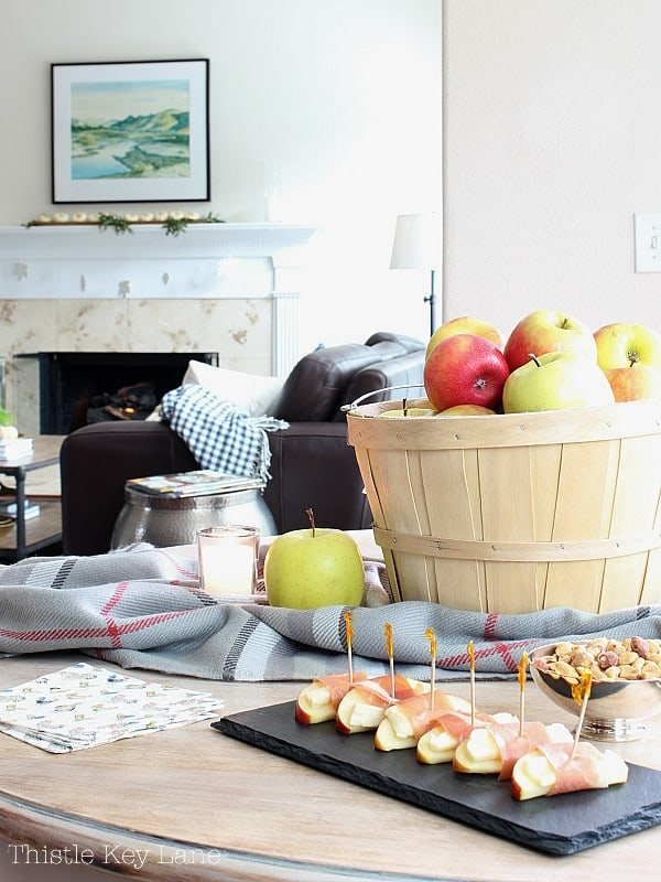 Bushel basket full of apples for a centerpiece and appetizers.