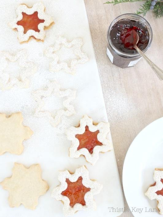 Snowflake cookie cutouts on a white background.
