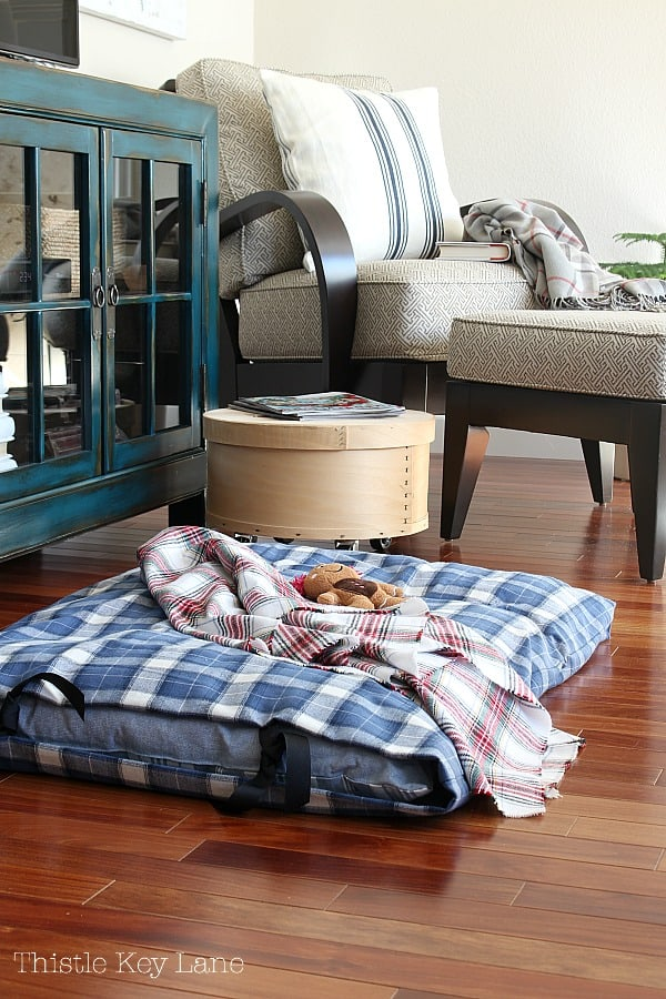 Plaid dog bed in the family room.