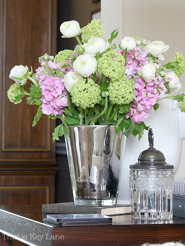 Valentine vignette with white, pink and green flowers.