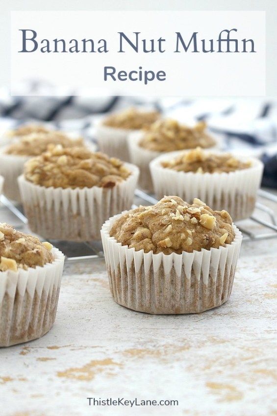 Banana Nut Muffins with paper liners on cooling rack.