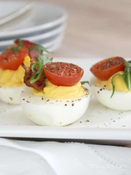 Deviled eggs with yummy toppings.
