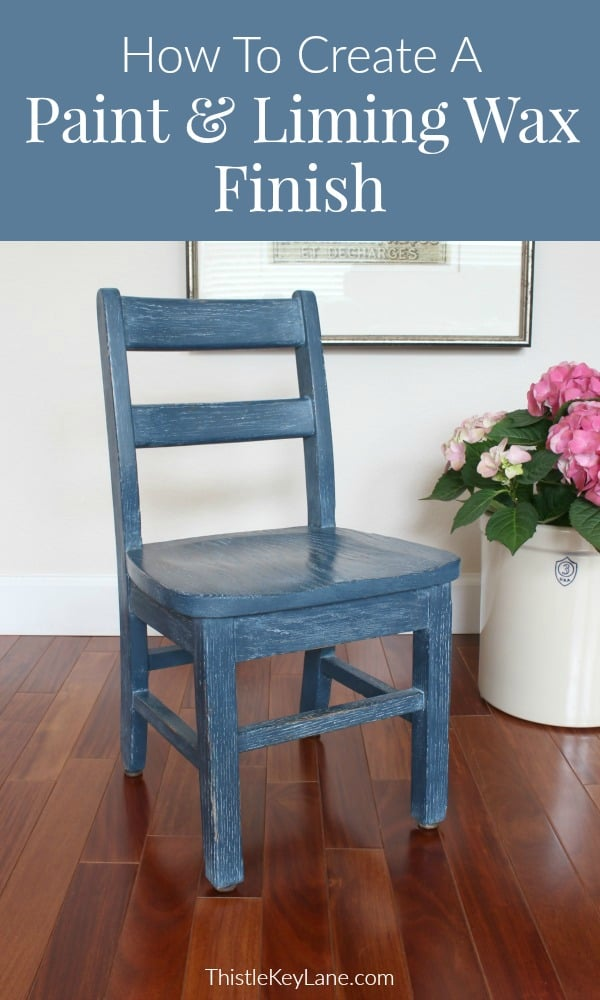 Small scale wood chair painted blue.