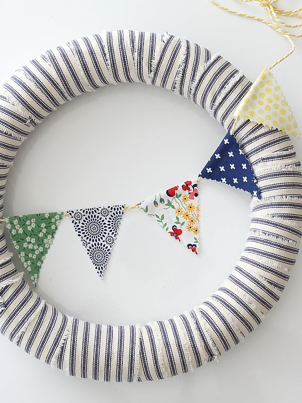 Ticking wreath with mini bunting.