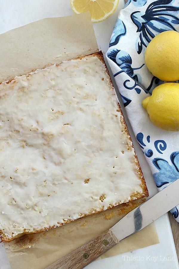 Lemon square recipe ready to cut and serve.