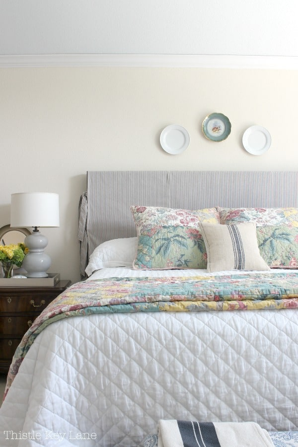 Updating a bedroom with patterns on bedding and headboard.