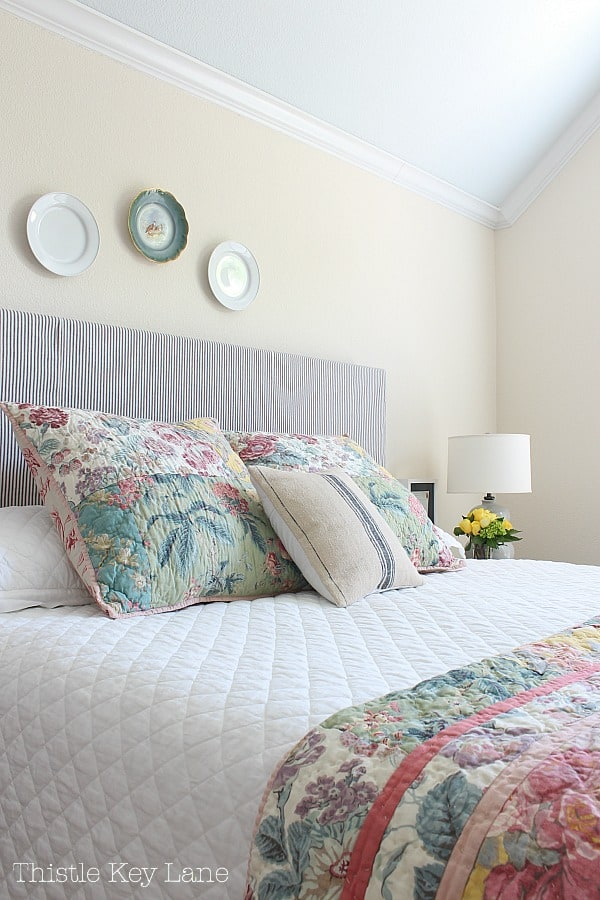 Updating a bedroom with patterns using pillows and a quilt.