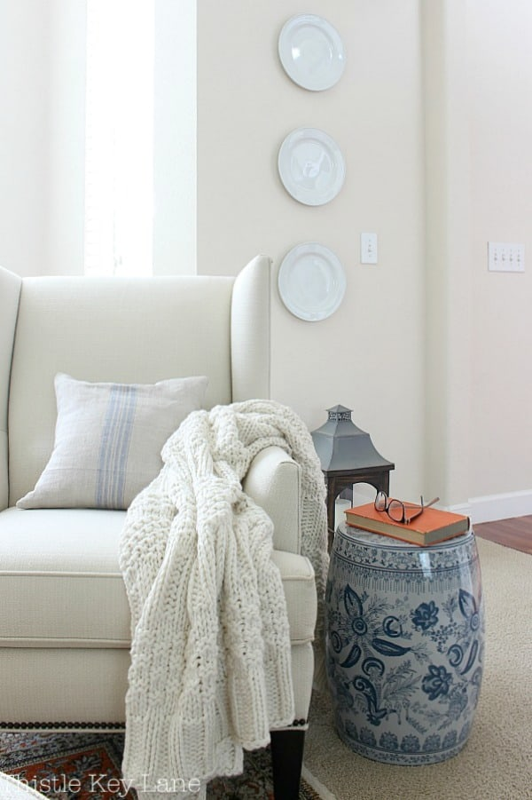 Decorating with plates in neutral room.