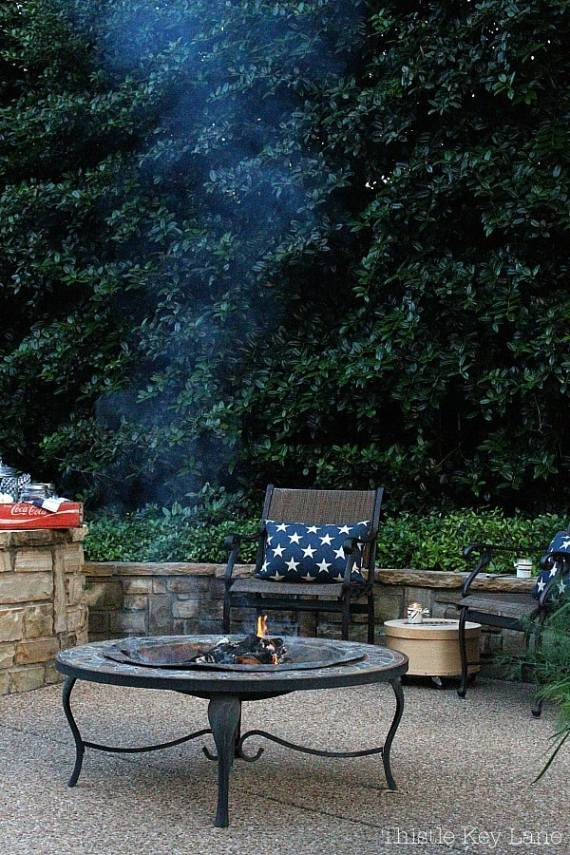 Summer patio with a fire pit, chairs and s'mores.
