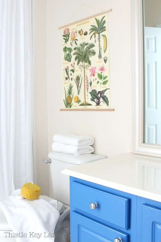 Updating a plain bathroom with art and towels.