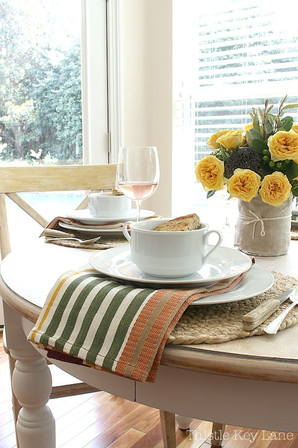 Easy fall tablescape with fun napkins and flowers.
