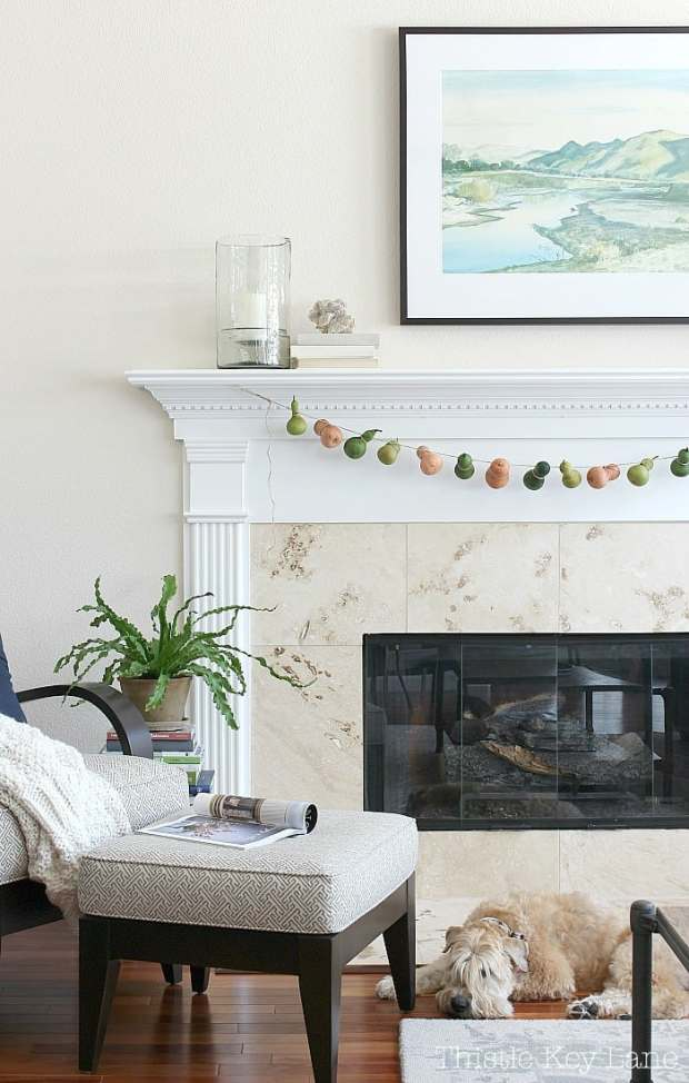 Summer to fall mantel and a gourd garland.