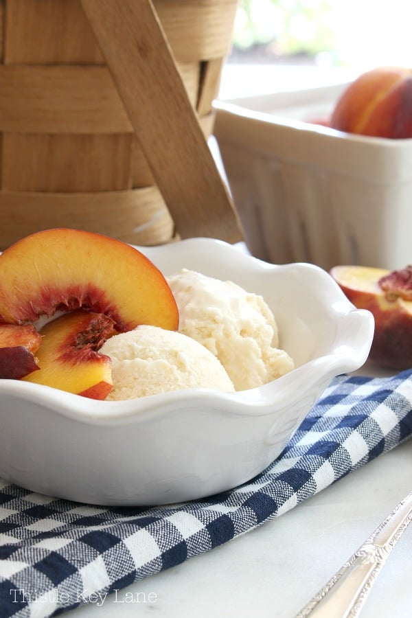 Sliced peaches on top of peach ice cream.