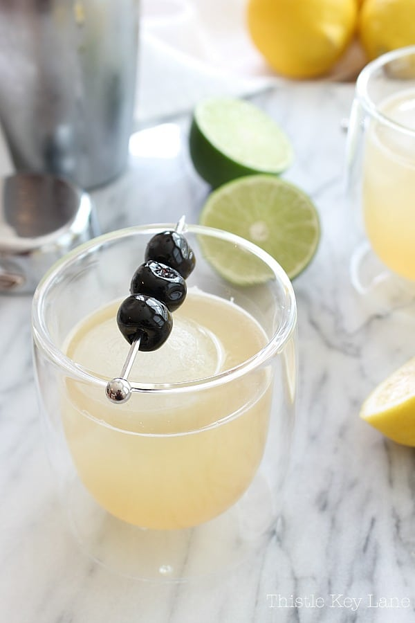 Classic whiskey sour cocktail recipe with fresh lemons and limes.
