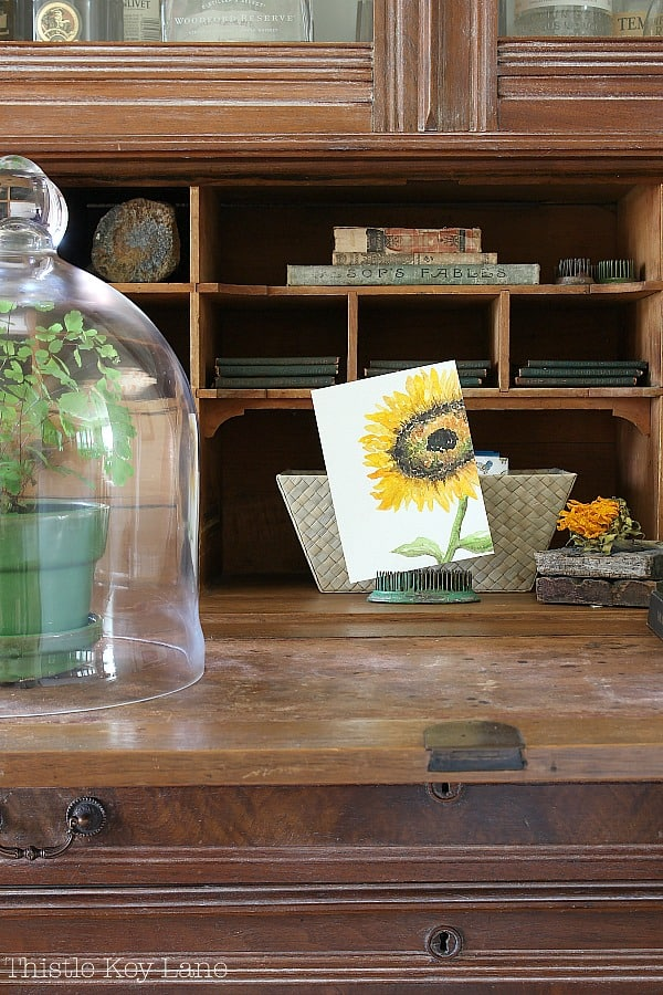 Simple Fall Home Decor Ideas - sunflower watercolor on a desk.