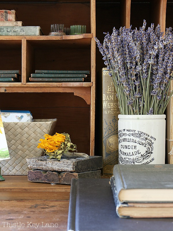 Vintage Dundee jar holding dried lavender.