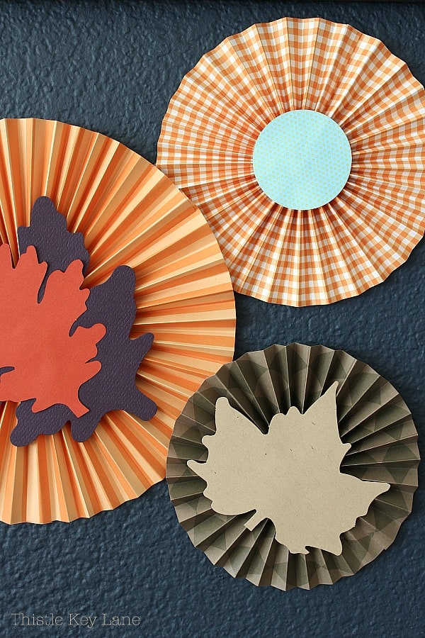 Fall paper medallions with navy background.