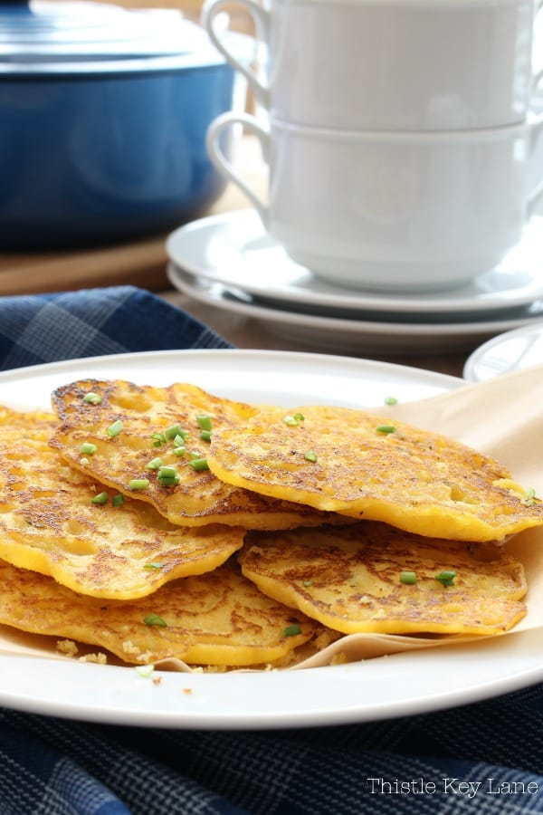 Johnny Cake Recipe With Green Onions And Chives - served with a bowl of chili.