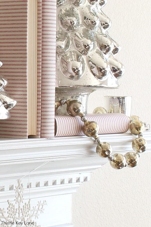 Mercury glass garland and red ticking stripe books