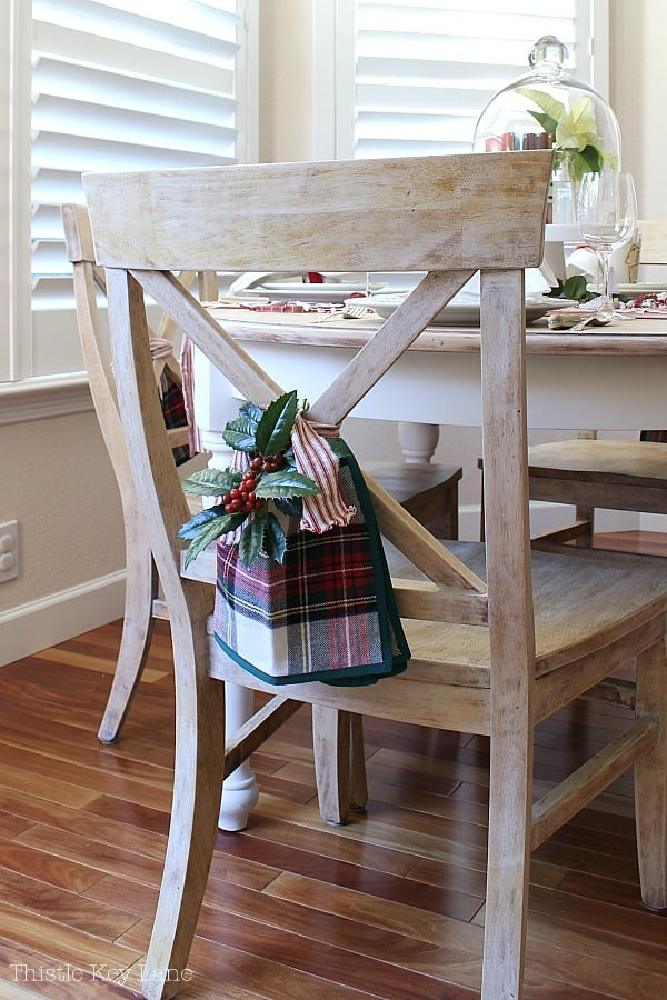 Chair back swag with holly, plaid and ticking.