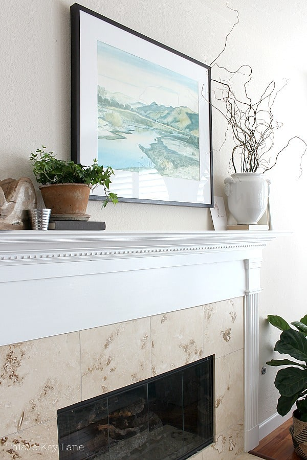 Early Spring Mantel Decorating Ideas with tall branches.