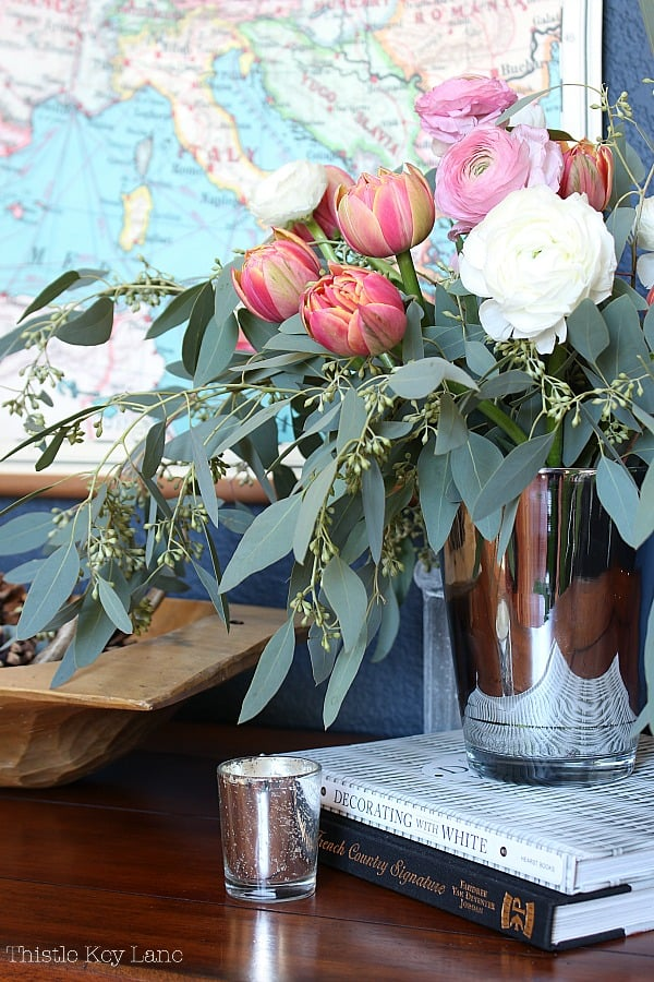 Create A Winter To Spring Entry Table featuring fresh flowers.