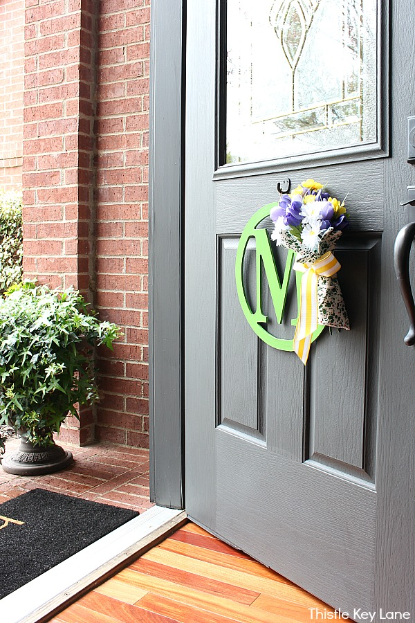 DIY Wreath With Garden Gloves and Flowers - front door brick wall and ivy.