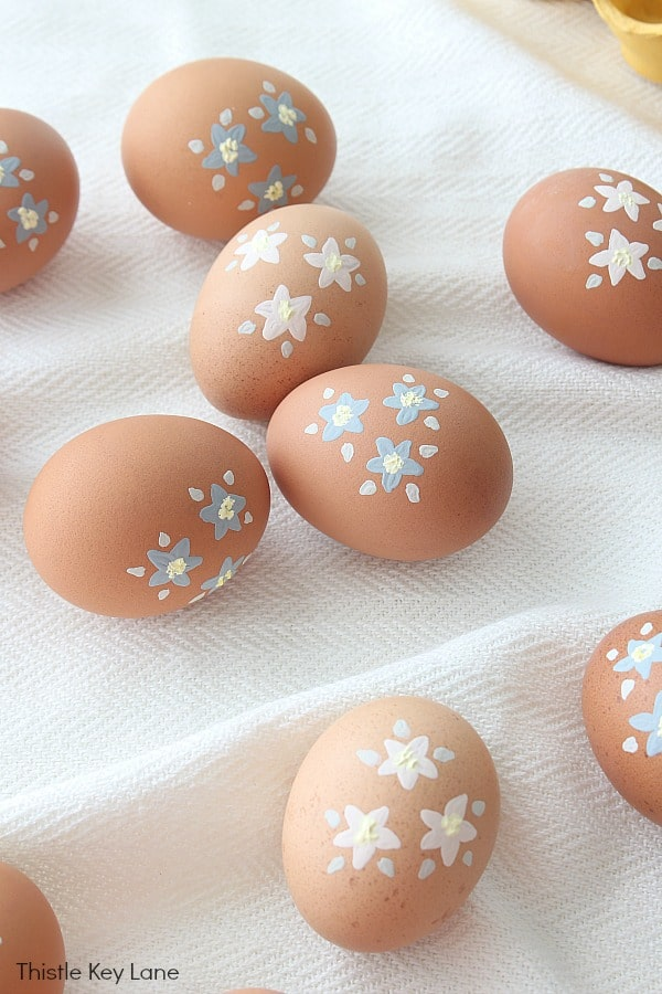 Ideas For Painting Brown Eggs - pink and blue flowers.