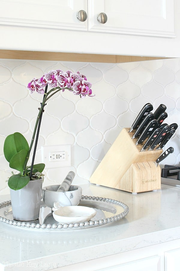 Easy Kitchen Organizing Tips - knife block and display tray with orchid.