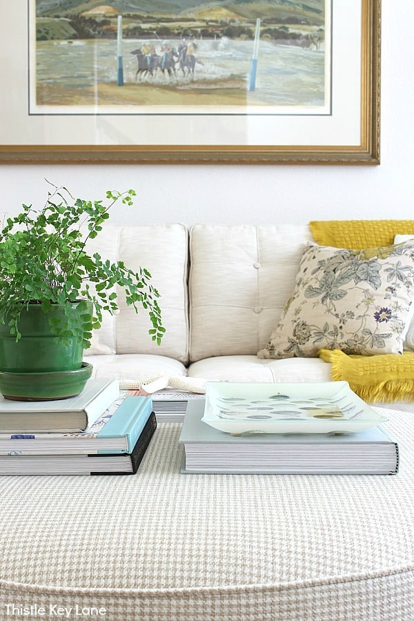 Spring Decorating Ideas For An Ottoman With Stacks Of Books