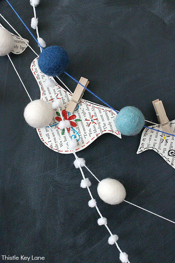 Book Page Bird Cutouts With Mini Clothespins And PomPom Garlands.