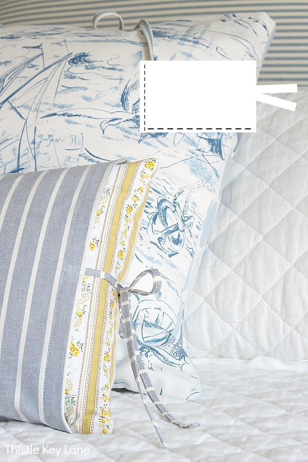 Ideas For Making Easy Pillow Covers With Ties - blue and white pillow covers on white quilt.