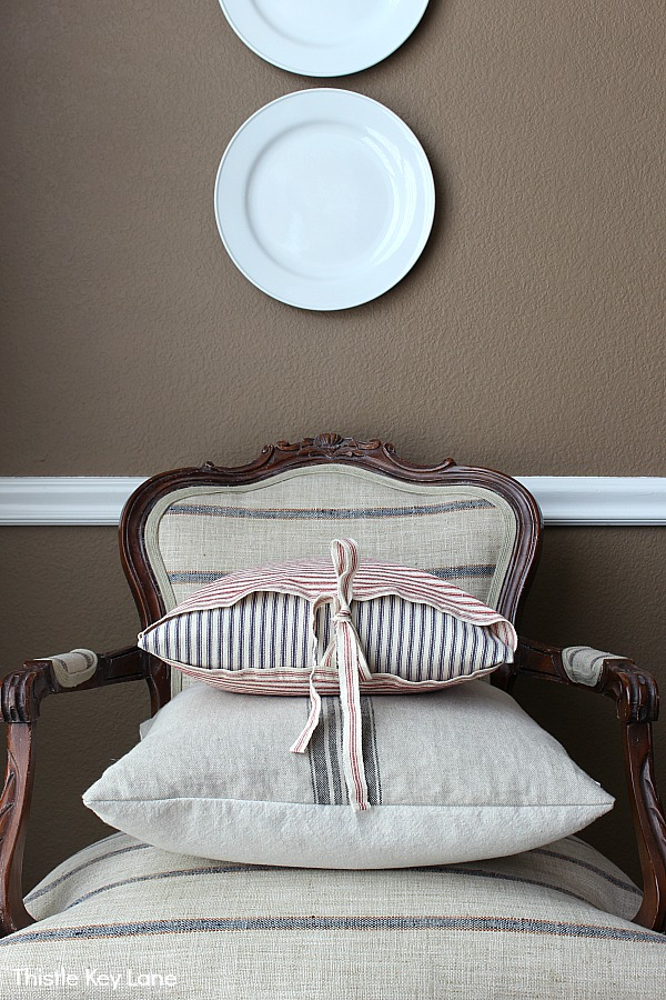 French arm chair with grain sack and picking pillows.
