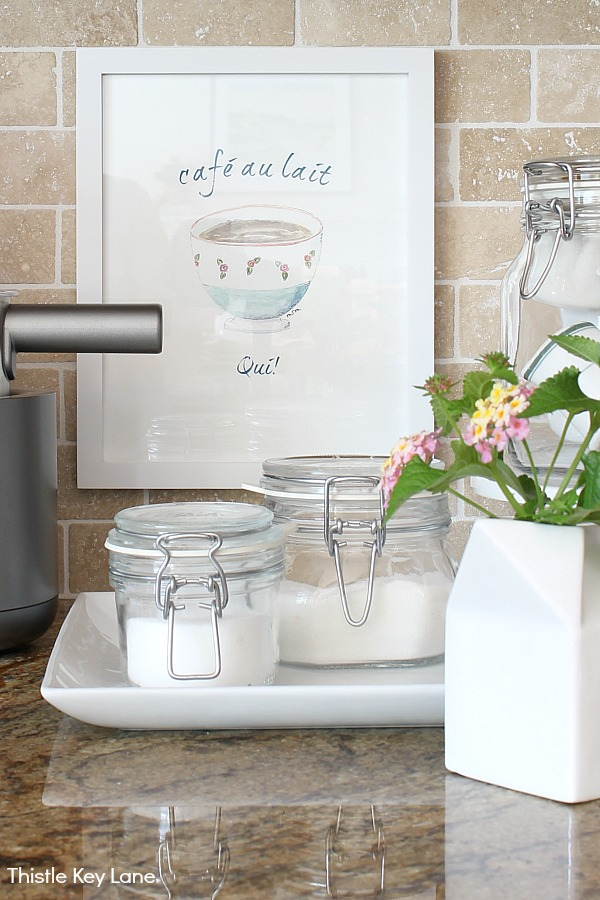 Sugar jars on kitchen counter with cafe ua lait artwork - Organizing A Coffee Station And A Free Printable