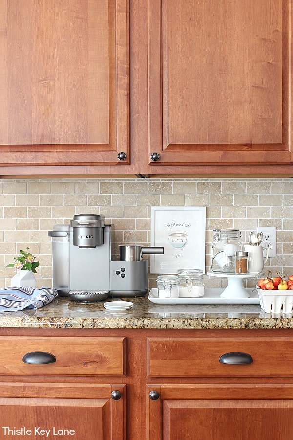 White accessories on counter with coffee maker - Organizing A Coffee Station And A Free Printable