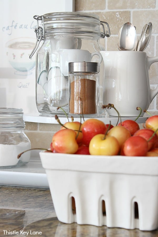 White basket of cherries on the kitchen counter - Organizing A Coffee Station And A Free Printable