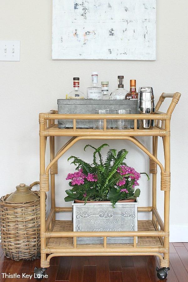 Styling A Bar Cart Three Ways - storing liquor bottles in a zinc drawer.