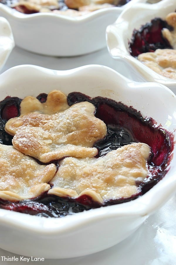 Individual berry cobblers in pie dishes.