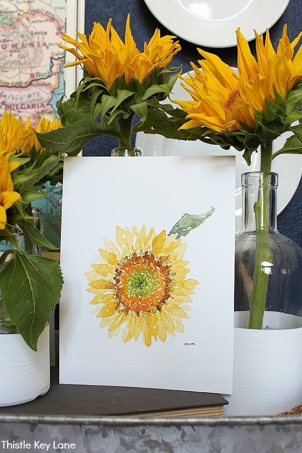 Sunflower watercolor surrounded by sunflowers in vases.
