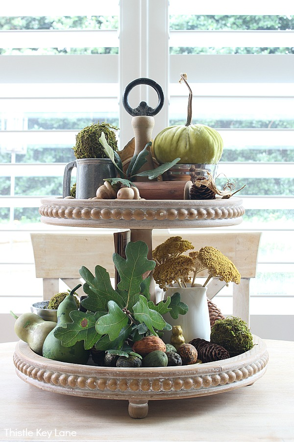 Fall tiered tray with acorns, leaves, dried flowers and gourds - Fall Tiered Tray With Greens And Browns.