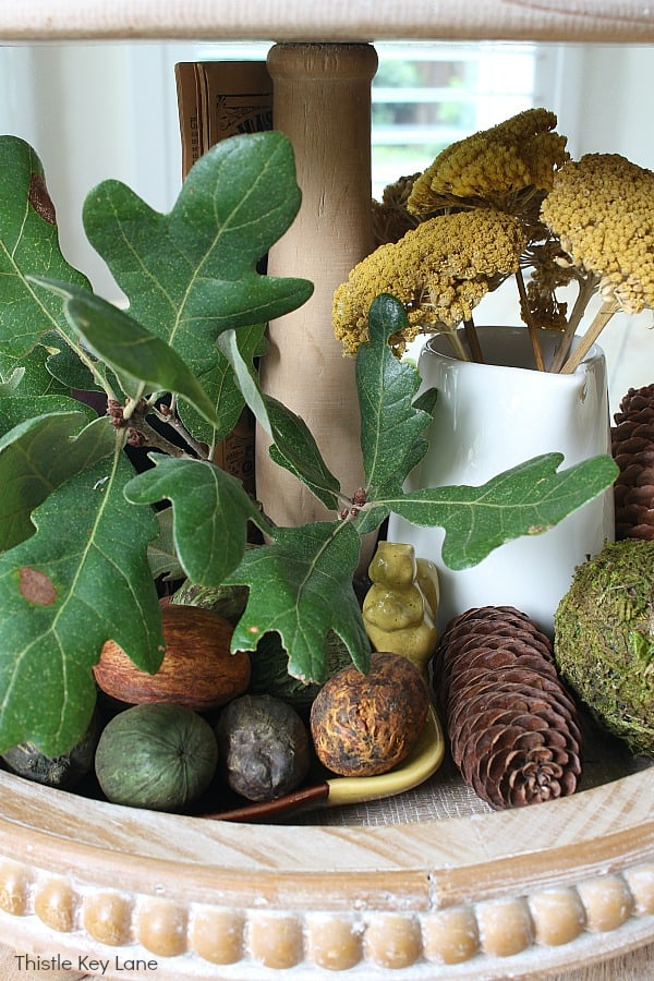 Oak leaves, nuts and a squirrel on a tiered tray. Fall Tiered Tray With Greens And Browns